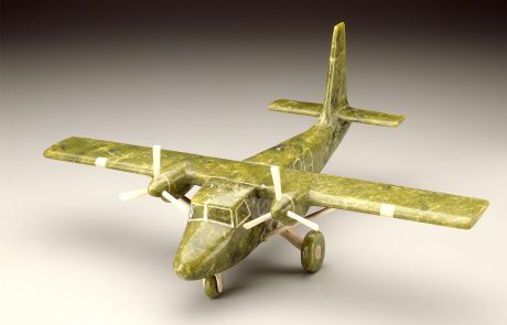 Sculpture of an twin-engine airplane in green coloured stone.