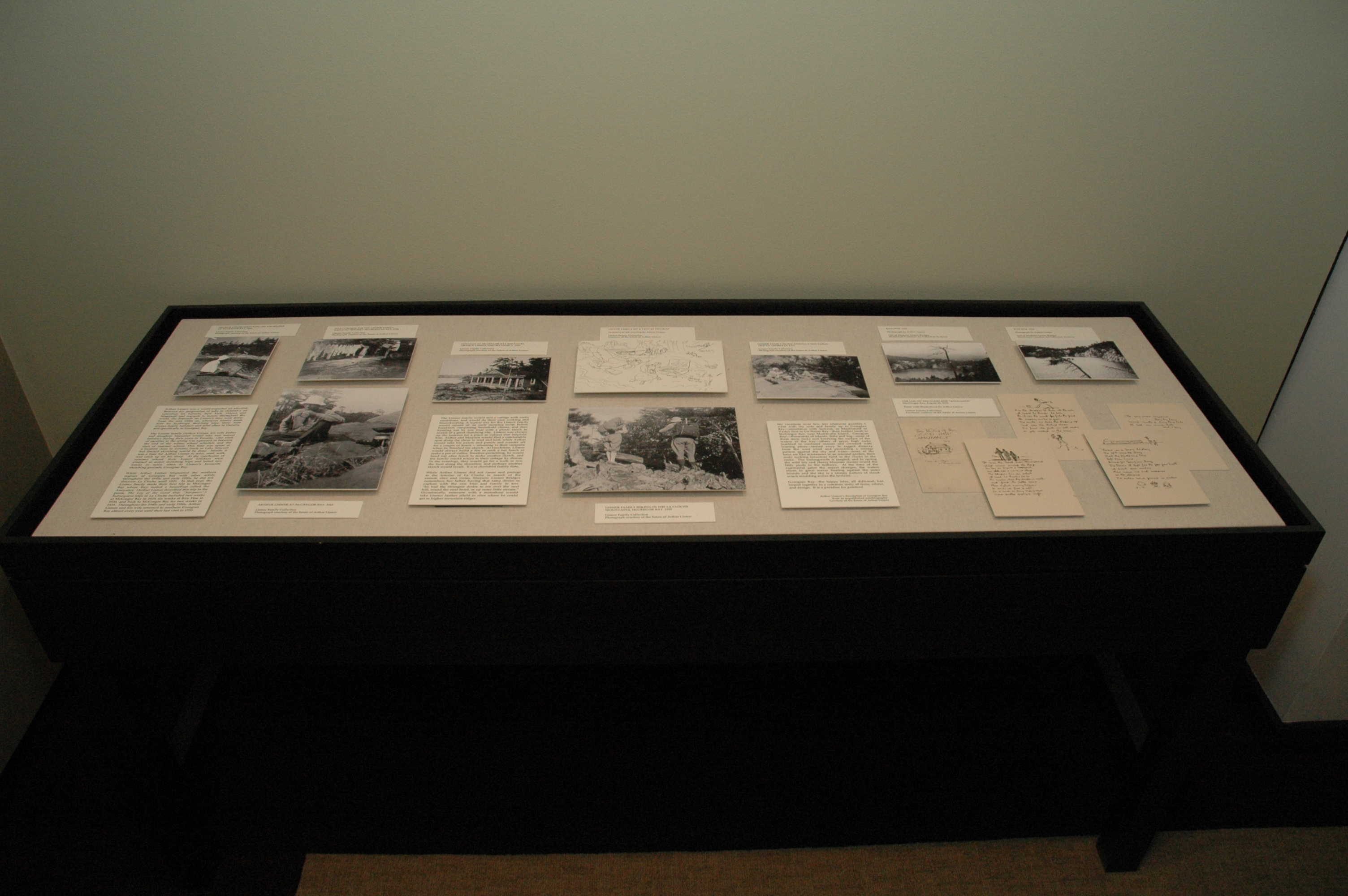 black and white photograph of a display case containing printed material
