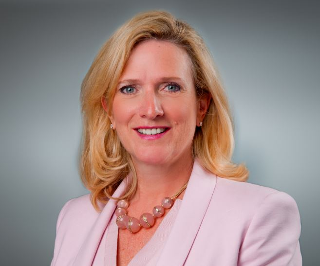 photo of head and shoulders of woman in pink suit