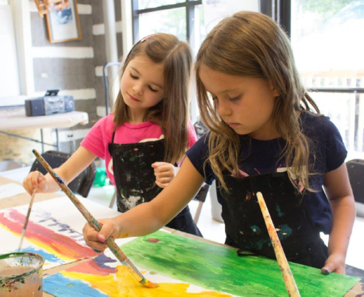 photograph of 2 little girls painting