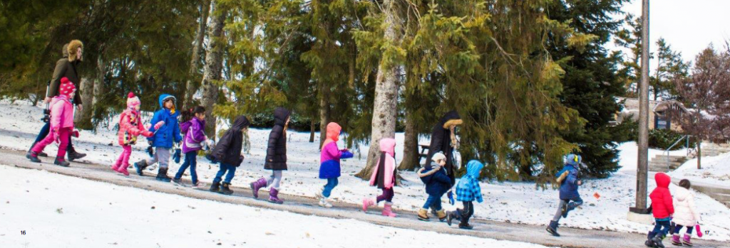 photograph of children walking in the snow