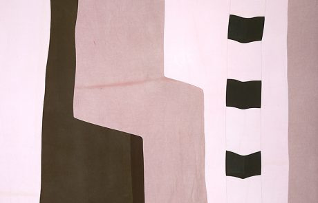 Cotton panel consisting of angular blocks of colour: black, white, pink and light purple.