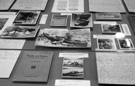 black and white photograph of documents, letters and books on a table