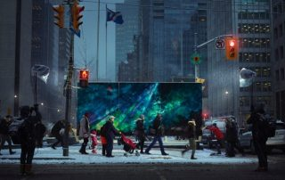 photograph of wintery streetscape with people walking past a large painting