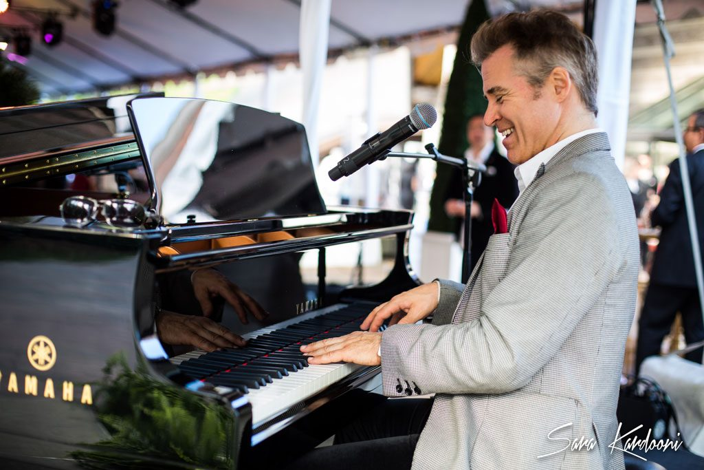 photograph of a man playing a grand piano